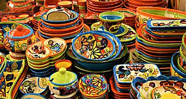 Piles of decorative ceramic plates in a souvenir shop in Barcelona, Spain