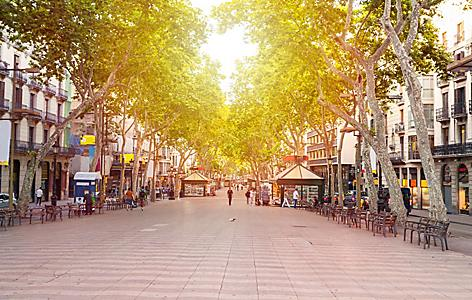 Street view of La Rambla in Barcelona, Spain, with shops lining the street