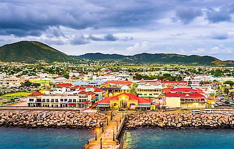 Boardwalk with traditional red houses in Nevis, Basseterre