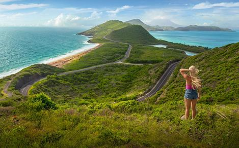 Girl Hiking Staring at the Coast. St. Kitts Nevis