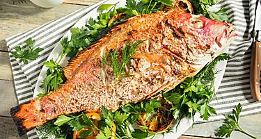 Grilled whole red snapper with lemons and dill