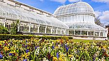 The exterior of the Palm House and exterior gardens in Belfast, Northern Ireland