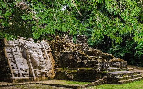 Caracol Mayan Ruins with Face Carving in Belize