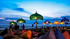 Hang out spot on the beaches of bali with pillows and lights