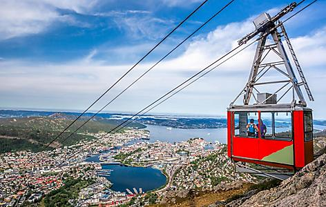 A cable car going up a mountain over Bergen, Norway