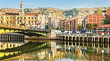 A bridge crossing over a river in Bilbao, Spain
