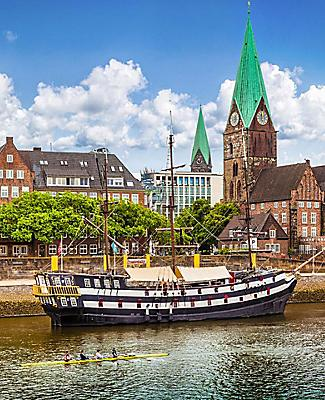 Historic town of Bremen with an old sailing ship on Weser river near Bremerhaven, Germany