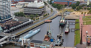 Cityscape seen from above, with a U-boat in the harbor of Bremerhaven, Germany