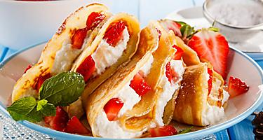 A crepe filled with strawberries and cream
