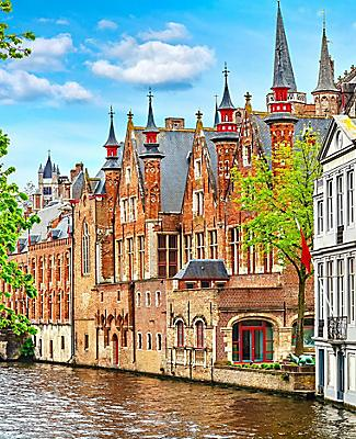 Old brick homes lining a canal in Bruges, Belgium