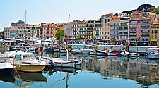 Boats docked at a harbor in Cannes, France