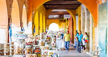 An outdoor market under a covered walkway in Cartagena, Colombia