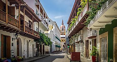 Buildings with balconies lining a street in Cartagena, Colombia