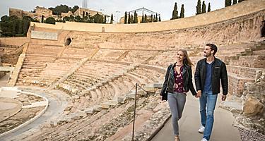 Couple Walking Through Spain's Roman Theater