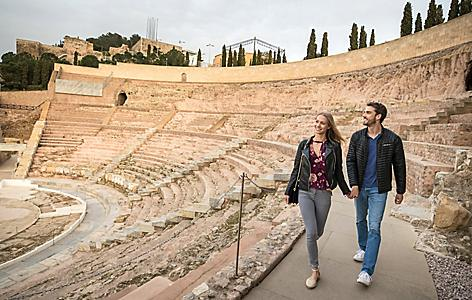 Couple Walking Through Spain's Roman Theater