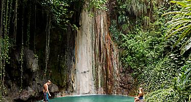 Couple relaxing in nature at a dry waterfall in Castries, St. Lucia