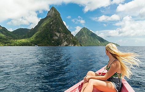 Girl on red canoe, sailing to the Pitons on Castries, St. Lucia