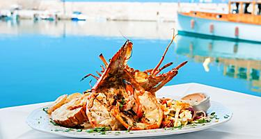 A plate with lobster served with vegetables in Chania, Crete