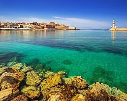 A lighthouse at the entrance to the old port in Chania, Crete