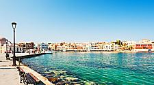 A panoramic view of the buildings lining the coast of Chania, Crete