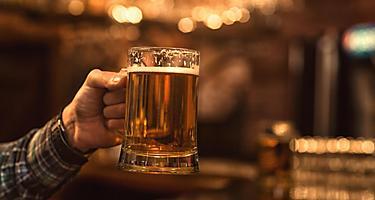A man holding a beer mug