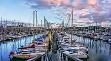 Boats docked at a marina in Cherbourg, France