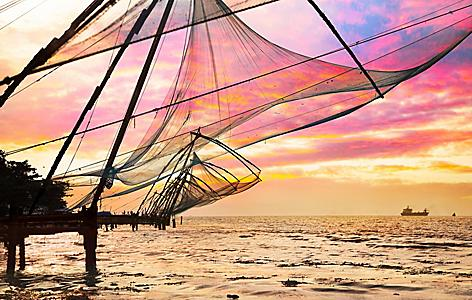 Chinese fishing nets hanging over the ocean in Cochin, India