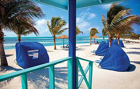 View of the beach with private day beds at CocoCay, Bahamas