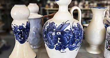 Traditional Greek ceramic pottery with blue floral decorations, on a shop in Corfu, Greece