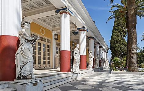 Statues in front of the pillars of the Achillion Palace in Corfu, Greece