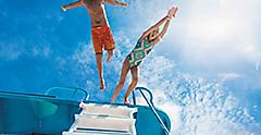Kids Jumping off a Boat into the Ocean, Cozumel, Mexico