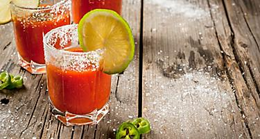 Michelada, Mexican drink made with beer and freshly squeezed lime juice over ice in a salt-rimmed glass.