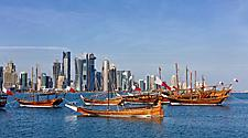 Traditional Arabic Dhow boats with Qatar flags in Doha, Qatar