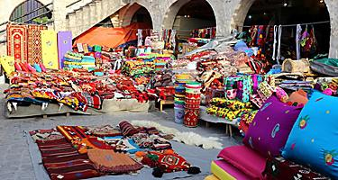 Colourful textiles on show at a shop in Souq Waqif market, Doha, Qatar