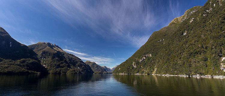 Between two mountains in the ocean in Doubtful Sound New Zealand