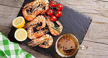 Grilled shrimp on a black board