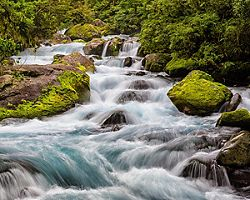 Close view of the stream that flows from Lake Marian to the Hollyford River in Fiorland National Park, New Zealand