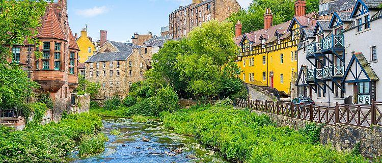 A river running through scenic Dean Village in Edinburgh, Scotland