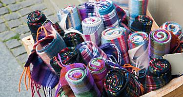 An assortment of rolled scarves for sale in Edinburgh