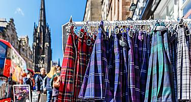 A rack full of tartan cloth kilts in Edinburgh, Scotland