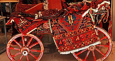 Homemade carpets on a cart