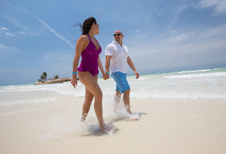 Couple Walking in Jamaica's White Beach