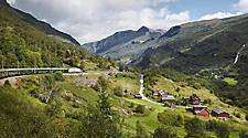 A train traveling through the countryside in Flam, Norway