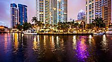 High rise building lit up at nightfall in Fort Lauderdale, Florida