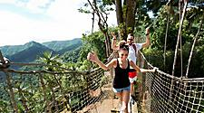 Couple crossing a suspension bridge in Fort de France, Martinique