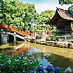 A red bridge over a water canal at the Dazaifu Tenmangu Shrine in Fukuoka, Japan