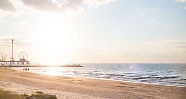 Quiet sunset at the beach by Pleasure Pier in Galveston, Texas