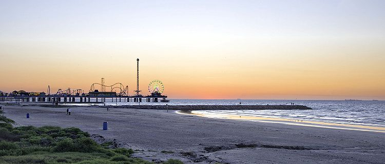 Early morning at the beach by Pleasure Pier in Galveston, Texas