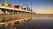 Sunrise at low tide on Pleasure Pier in Galveston, Texas