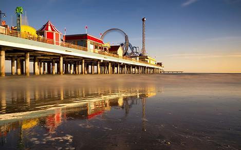 Sunrise at low tide on Pleasure Pier in Galveston, Texas